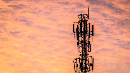 telecommunication tower with sunset as the background