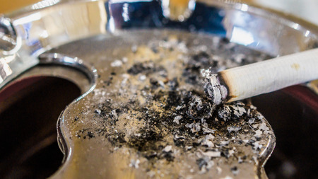 cigarette on metallic ashtray