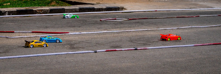 remote control car race competition on tarmac circuit 写真素材