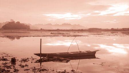 beautiful panorama of sunrise at Benanga Reservoir, Samarinda, East Kalimantan, Indonesia Banco de Imagens