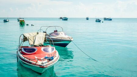 beautiful scenery at Derawan Island. Boats docked in the port with crystal clear water