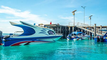 Berau / Indonesia - 10/14/2019: boats docked at the Derawan Island port waiting for passengers