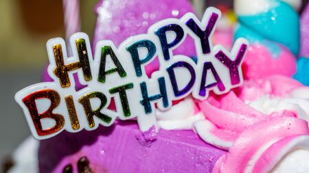 Happy birthday sign on colorful cake