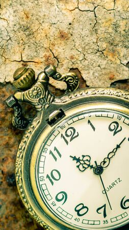 Vintage pocket watch showing time with textured background. concept of time
