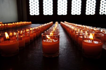 Lines of Candle in glasses  photo