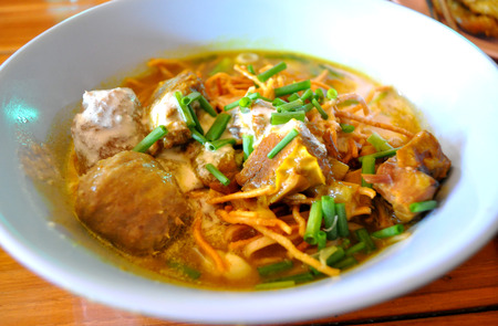 Khao Soi - Thai style noodle with pork curry soup photo