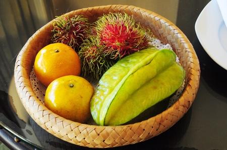 Tropical fruit - Rambutan, Orange, Star fruit photo