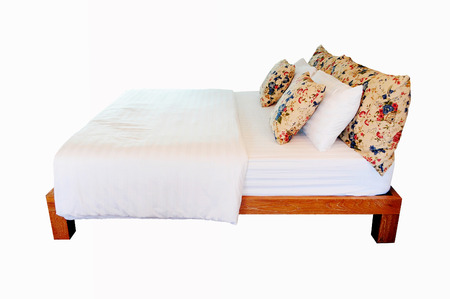 Vintage bed on isolated white background photo