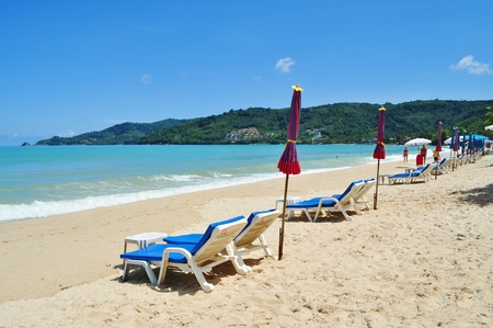 Beach chairs and beach umbrella photo