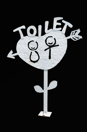 Toilet standing signage on isolated black bakground photo