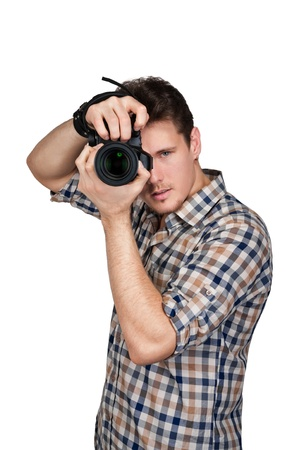 Photographer with a camera in the studio photo