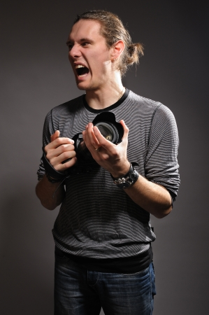 The crazy and young photographer photo