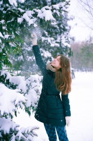 woman next to the Christmas tree Stock Photo - 18207543