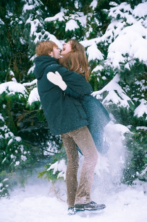 Young couple enjoys the white snow photo