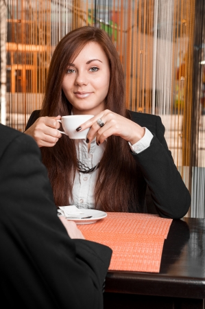 businesswoman drinking coffee photo