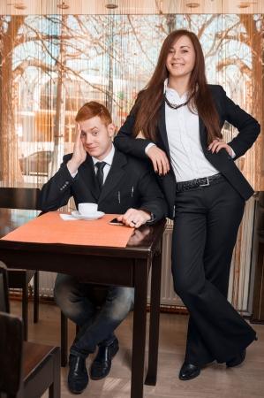 dominate: Women dominate over men Stock Photo