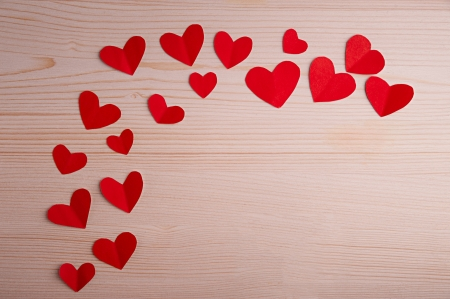 little red hearts on a wooden table Banco de Imagens - 24428153