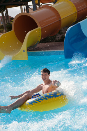 water activity: man rides in the water park Stock Photo