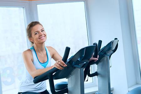 stationary bike: Happy woman on a stationary bike