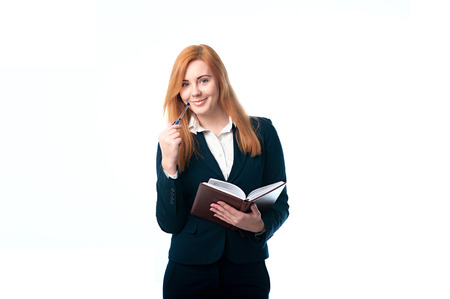 Beautiful business woman holding a diary