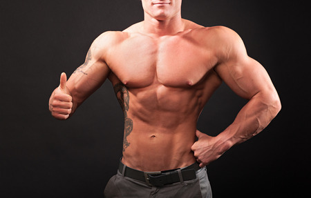 only the biceps: strong man showing thumbs up