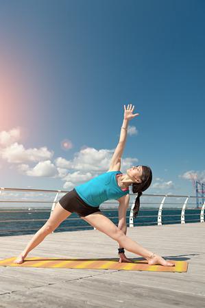 elongated: Yoga. Pose elongated triangle