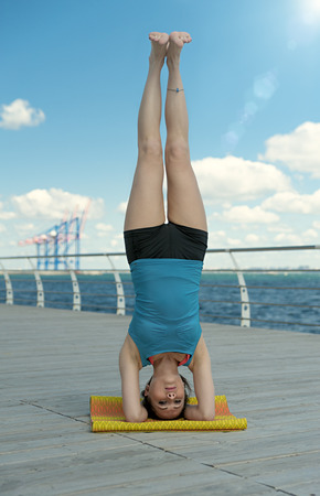 headstand: Yoga. Headstand on sea background Stock Photo