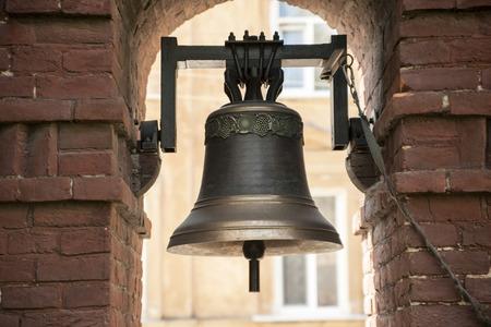 bell bronze bell: The old bronze bell near the brick wall