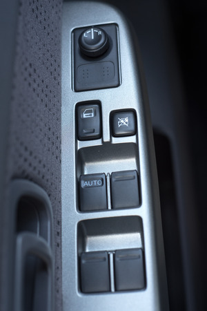 drivers seat: button on the door of the drivers seat Stock Photo