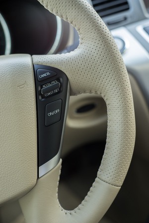quieter: White leather steering wheel car