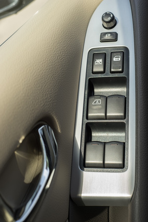lift lock: button on the door of the drivers seat Stock Photo
