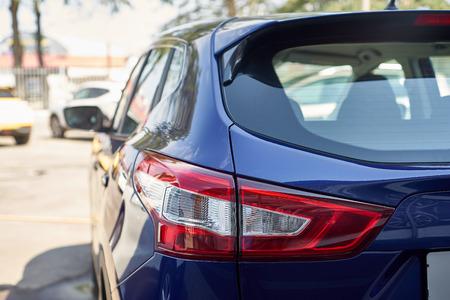 Elegant blue car headlight outdoors