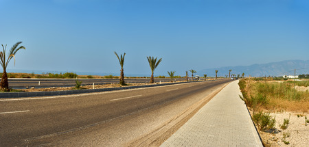 farther: road in the desert turns to the right Stock Photo