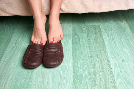 woman laying: female feet and slippers Stock Photo
