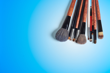 makeup brush and cosmetics, on a color background Imagens