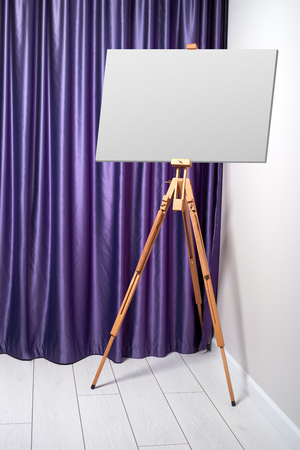 indoors: easel indoors Stock Photo