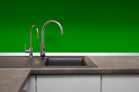 stainless steel sink: stainless steel sink and faucet in kitchen room