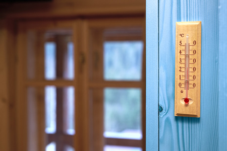 rising temperature: thermometer in the room Stock Photo