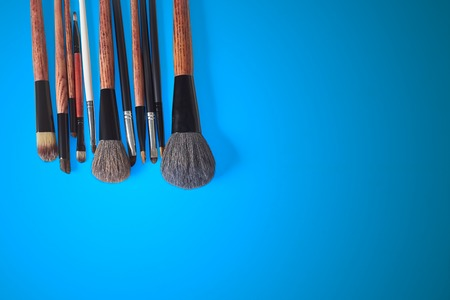 eyemakeup: makeup brush on a blue background Stock Photo