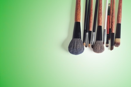 eyemakeup: makeup brush on a green background