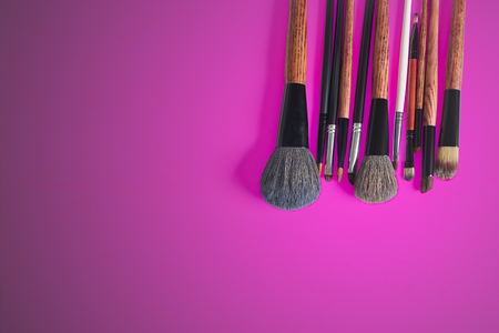 eyemakeup: makeup brush on a purple background