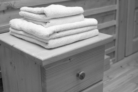 drawers: wooden chest of drawers with bath towel Stock Photo