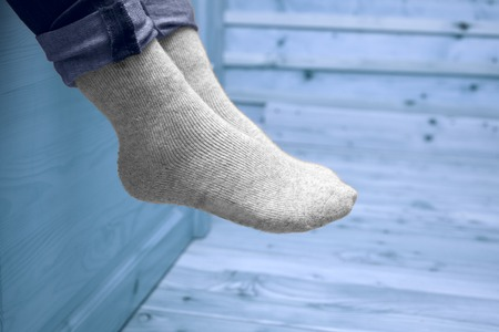 female legs in woolen socks
