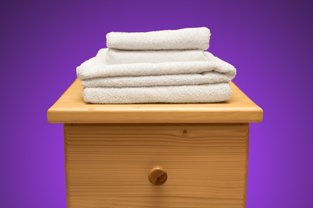 drawers: chest of drawers with a clean towel