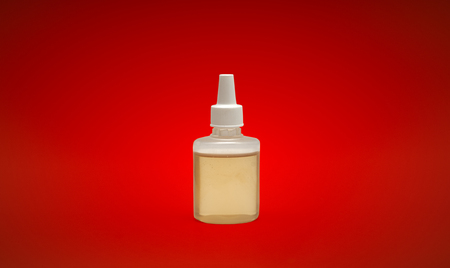 bottle nose: Brown medicine bottle on a background