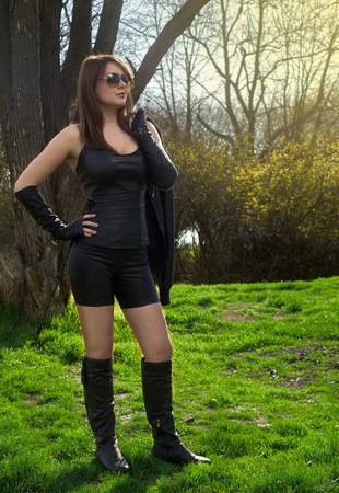 woman in leather clothes with whip Stock Photo