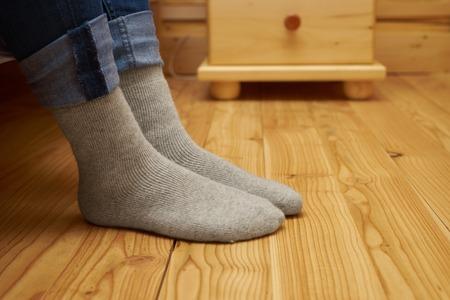 female legs in woolen socks
