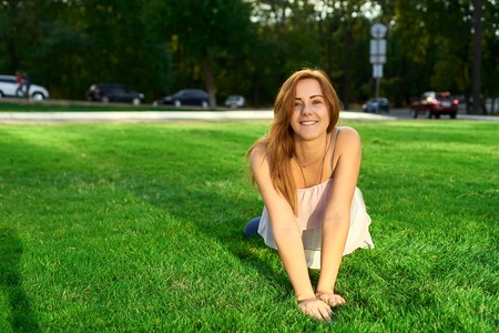 grass beautiful: happy woman with glasses lying on the grass Stock Photo