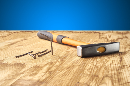 hammer and nails on the wooden table