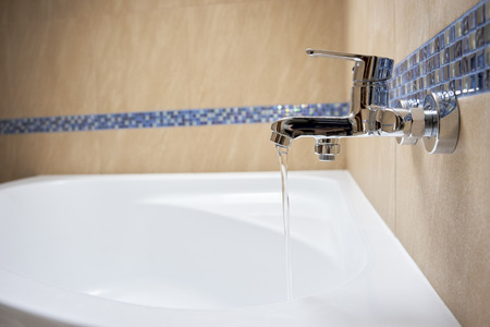 water flows from the tap in the bathroom